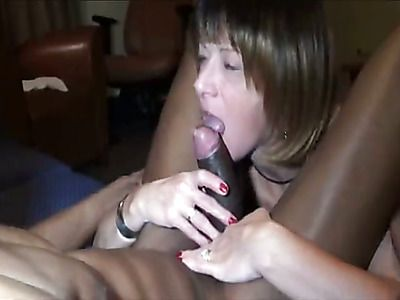 Mature wife sucks on a big black cock.
