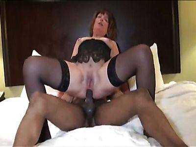 Mature woman in sexy lingerie seduces black lover.