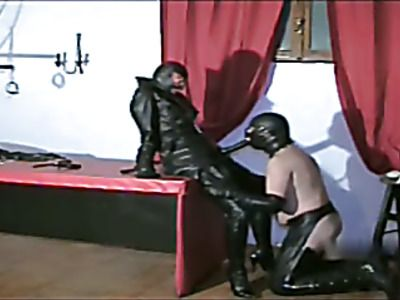 Woman in Leather and latex fucks her slave