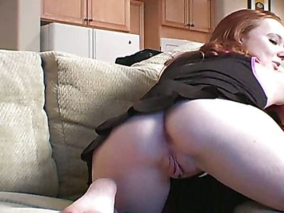 Stunning redhead shows what satisfies her