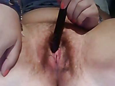 Horny slut rubs her pussy with a toy.