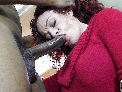 Interracial deepthroat in front of the cam