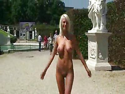 Glamorous blonde walks around outside naked in public